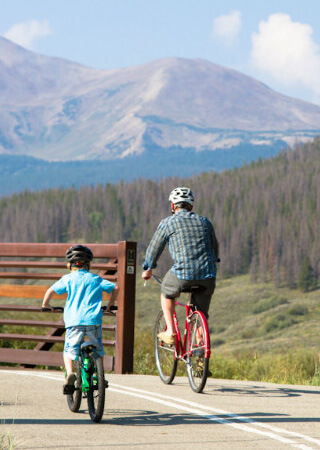 Father and Son biking together.