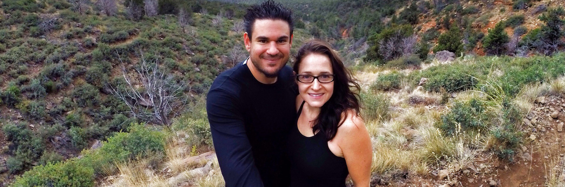 Couple hiking on a trail in Sedona wilderness.